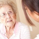 Elderly woman talking to nurse